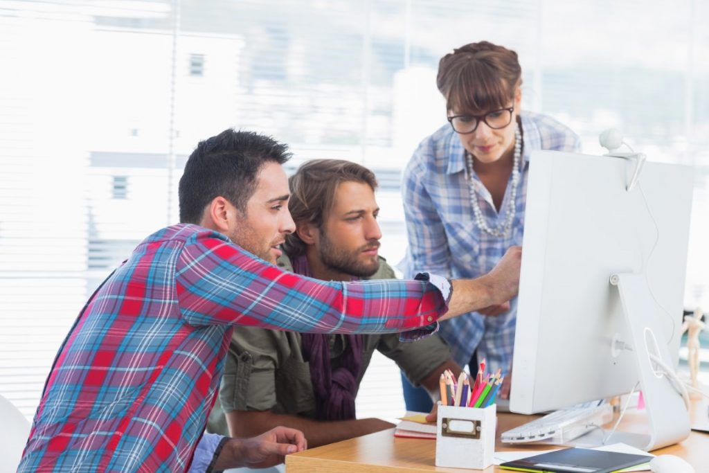 3 Designers looking at screen