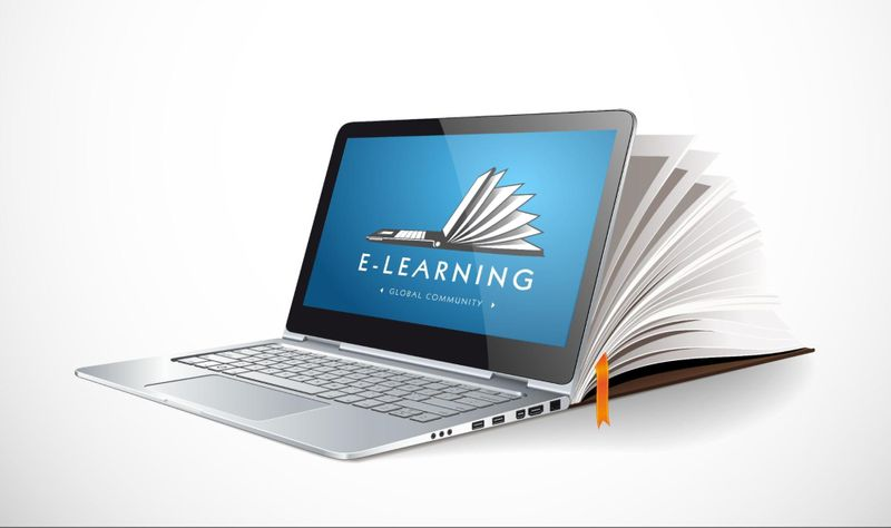 """Training manual fused with laptop displaying the phrase """"E-Learning"""""""