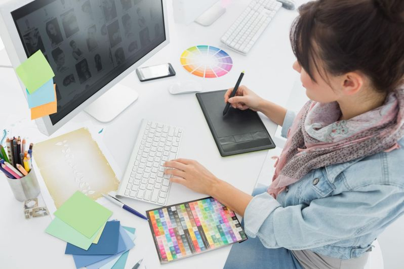 Fashionable graphic designer using drawing tablet to create animated explainer video